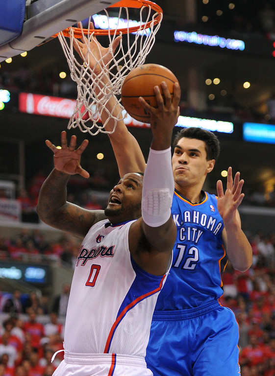 . The Clippers\' Glen Davis puts up a shot under the basket against the Thunders\' Steven Adams in game six of the Western Conference semifinals, Thursday, May 15, 2014, at Staples Center. (Photo by Michael Owen Baker/Los Angeles Daily News)