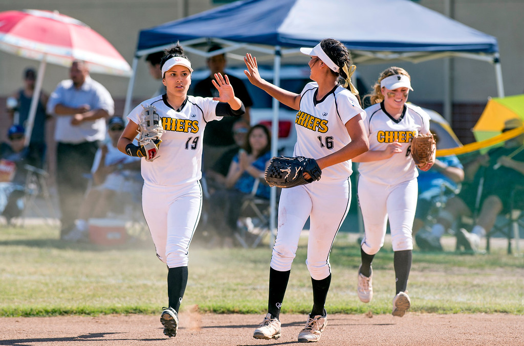 . Santa Fe High right fielder Yulissa Dominguez, left, is congratulated after a sliding catch vs California High at the Santa Fe Springs campus field May 13, 2014.   (Staff photo by Leo Jarzomb/Whittier Daily News)