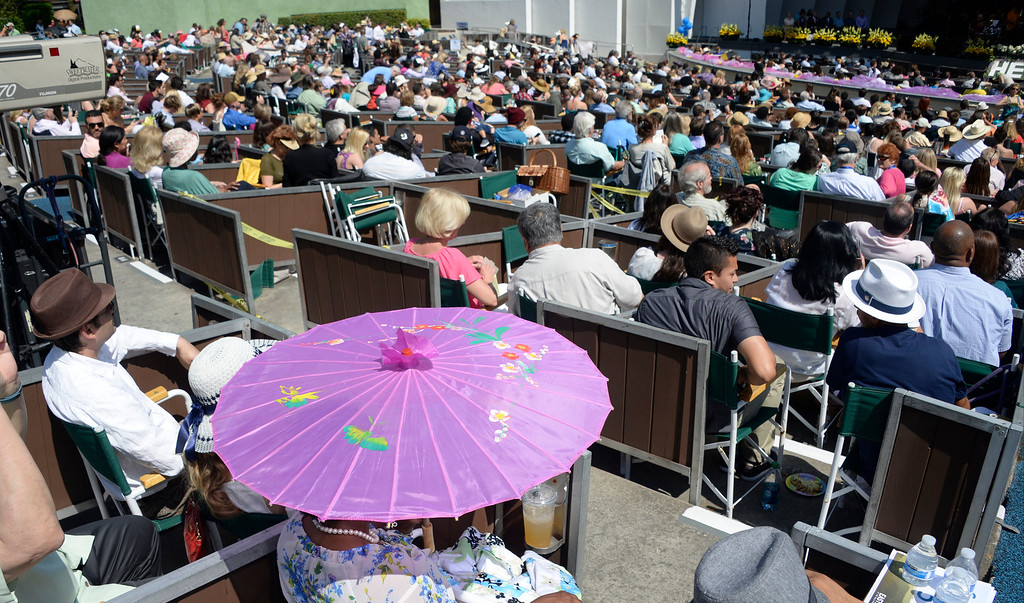 . April 20,2014, Hollywood CA. Women displaying colorful umbrellas  during the 2014 Hollywood bowl easter service by the Christian Assembly Church, Fellowship Monrovia, and Bel Air Presbyterian Church.  Photo by Gene Blevins/LA Daily News