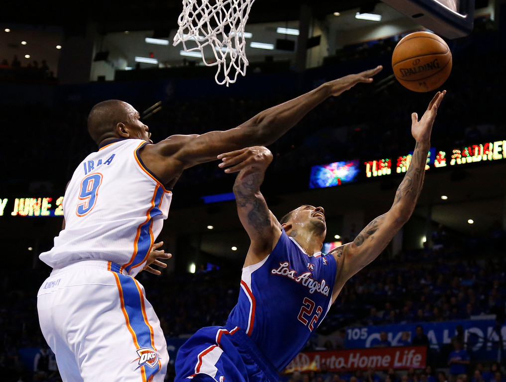 . Oklahoma City Thunder forward Serge Ibaka (9) blocks a shot by Los Angeles Clippers forward Matt Barnes (22) in the first quarter of Game 1 of the Western Conference semifinal NBA basketball playoff series in Oklahoma City, Monday, May 5, 2014. (AP Photo/Sue Ogrocki)