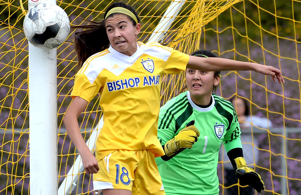 . Bishop Amat\'s Alexis Rushlow (18) looks on along with goal keeper Evelyn Fierros (1) as Diamond Bar\'s Helena Kisor (not pictured) misses wide in the second half of a CIF-SS second round prep playoff soccer match at Diamond Bar High School in Diamond Bar, Calif., on Wednesday, Feb.26, 2014. Diamond Bar won 3-2.