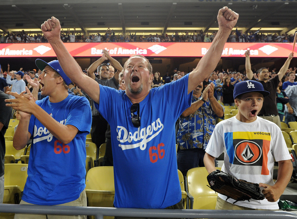 . Fans cheer a 9th inning home run by Andre Ethier. Fans at Dodger Stadium have been treated to a lot of excitement. The Dodgers defeated the New York Mets 5-4 in 12 innings Wednesday night at Dodger Stadium in Los Angeles, CA. 8/13/2013(John McCoy/LA Daily News)