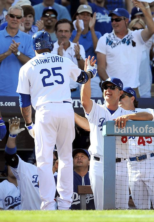 . The Dodgers\' Carl Crawford is congratulated after hitting a homerun in the 5th inning against the Cardinals during game 5 of the NLCS at Dodger Stadium Wednesday, October 16, 2013.(Hans Gutknecht/Los Angeles Daily News)