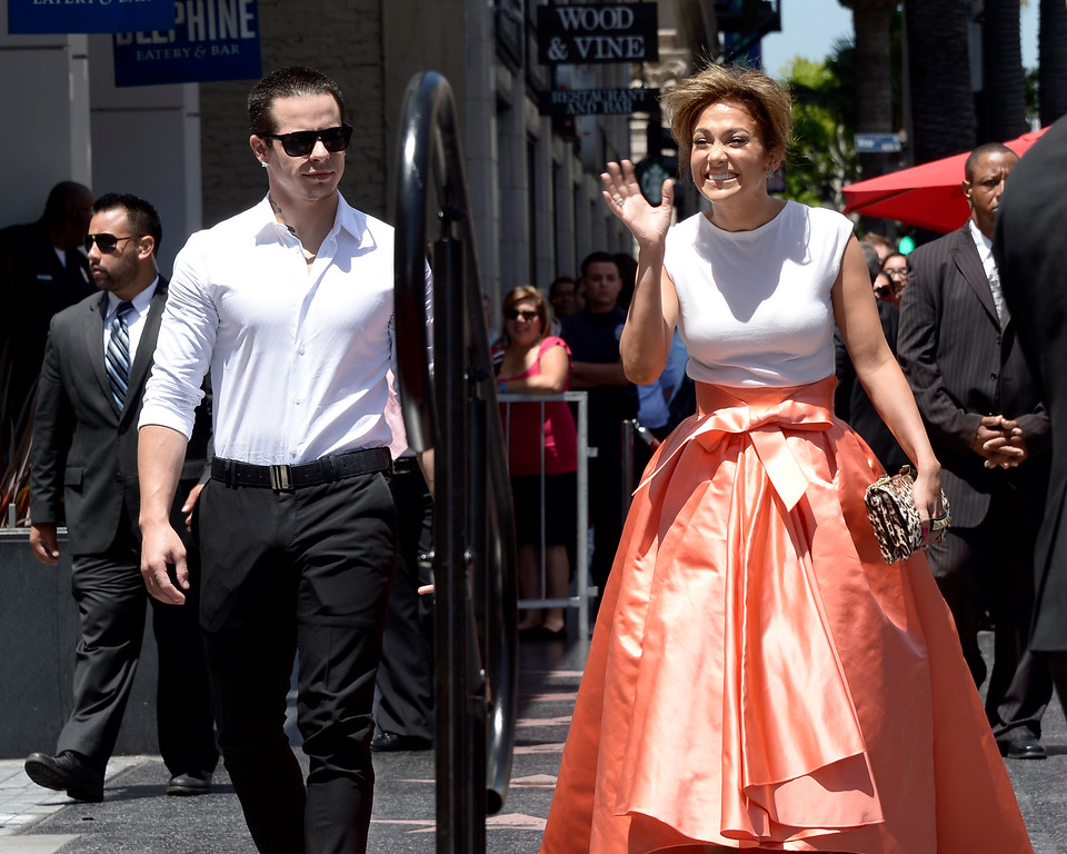 . US actress, singer Jennifer Lopez (R) and boyfriend, US actor Casper Smart (L) arrive for Lopez\'  star ceremony on the Hollywood Walk of Fame in Hollywood, California, USA 20 June 2013. Lopez was awarded the 2,500th star on the Hollywood Walk of Fame in the category of Recording.  EPA/PAUL BUCK