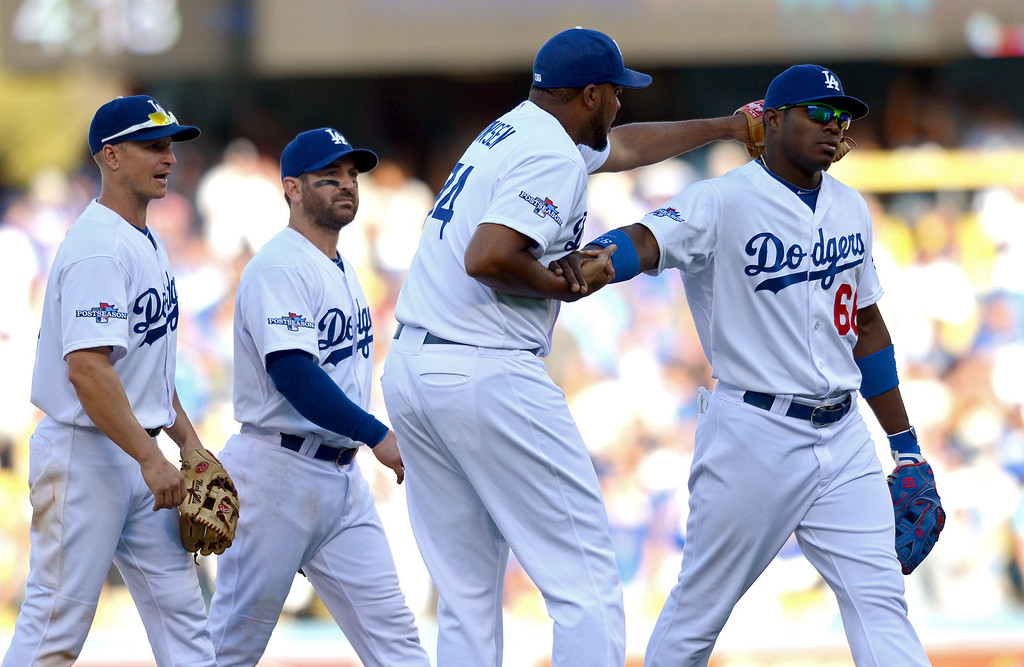 . The Dodgers exit the field after beating the Cardinals 6-4 in game 5 of the NLCS at Dodger Stadium Wednesday, October 16, 2013.(David Crane/Los Angeles Daily News)