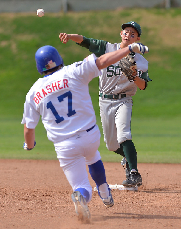 . 0509_SPT_TDB-L-SOUTH-ELSEG--- El Segundo, CALIFORNIA--5/8/13--- Staff Photo: Robert Casillas / LANG--- South Torrance defeated host El Segundo 6-3 in Pioneer League baseball game. South second baseman Perry Richmond turns double play on approaching  Austin Brasher