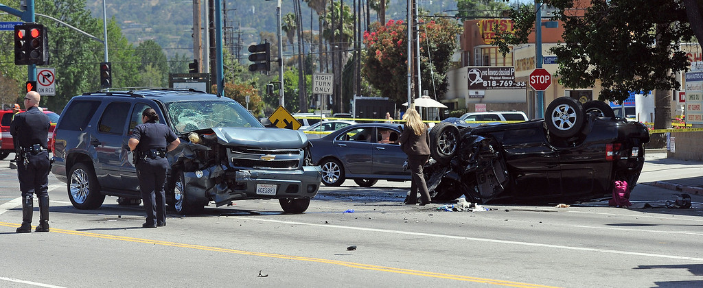 . Los Angeles Police investigate the scene of a fatal 3 vehicle accident at the intersection of Lankershim Blvd., Vineland Ave. and Camarillo St. in North Hollywood Wednesday, June 19, 2013. A vehicle traveling at a high rate of speed ran a red light causing the collision according to LAPD officer Harvey Freeman. (Hans Gutknecht/Los Angeles Daily News)