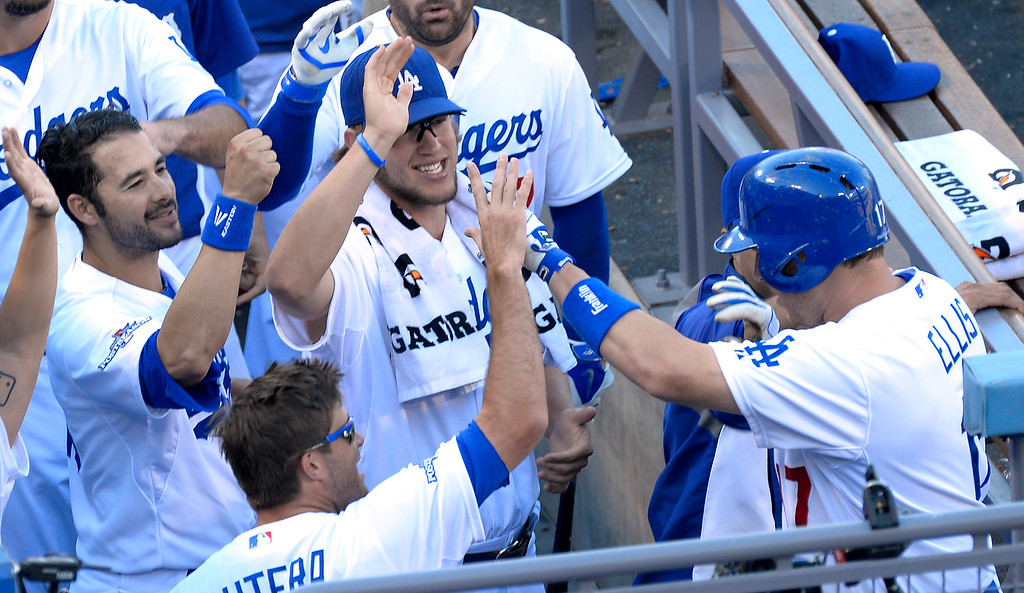 . Dodgers#17 A.J. Ellis is congratulated after his 7th inning solo homer. The Dodgers played the Saint Louis Cardinals in game 5 of the National League Championship Series at Dodger Stadium in Los Angeles, CA. 10/15/2013. photo by (John McCoy)/Los Angeles Daily News)