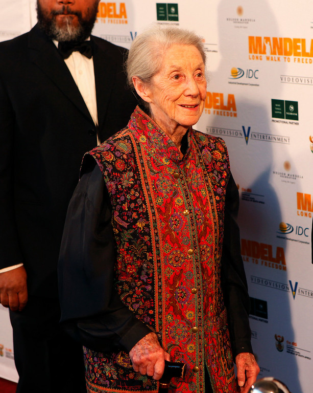 ". In this photo taken Sunday, Nov. 3, 2013, Nobel Priize winning author  Nadine Gordimer, arrives for the South African premier of the movie ""Mandela - Long Walk To Freedom\"" in Johannesburg. Gordimer died peacefully in her sleep Sunday, July 13, 2014 aged 90, her family said Monday. (AP Photo/Denis Farrell)"