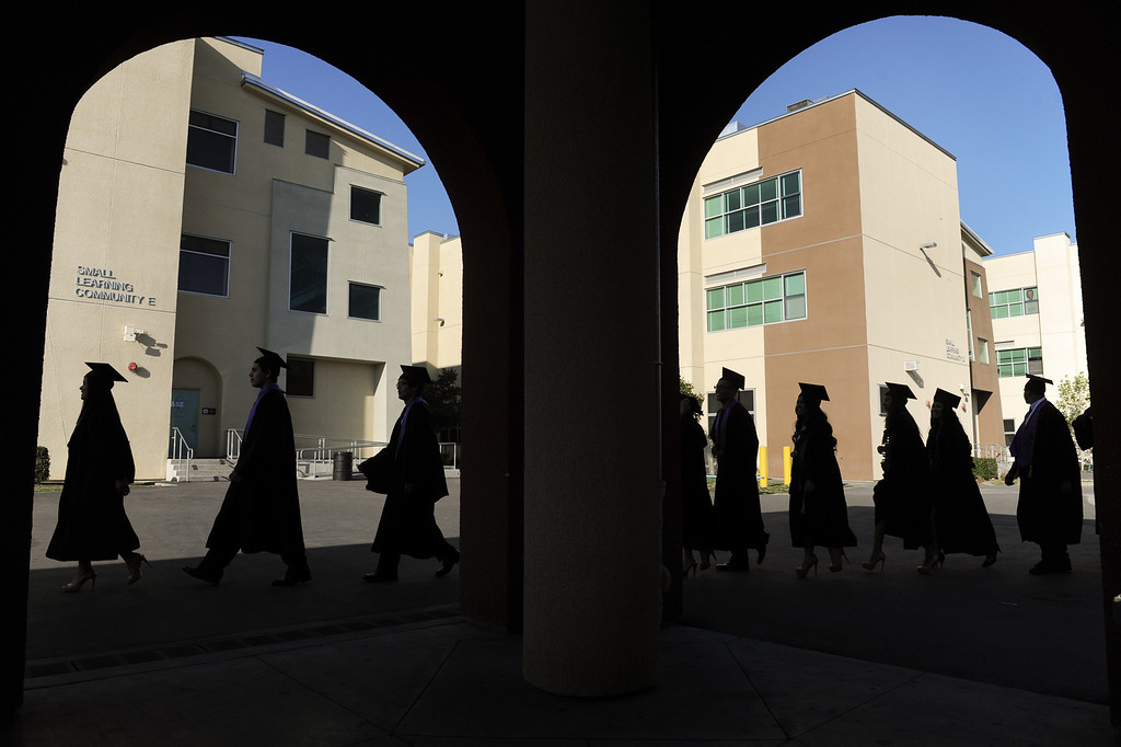 . Graduates walk through the Cesar Chavez Learning Academies campus for the Social Justice Humanitas Academy graduation in San Fernando, Wednesday, June 5, 2013. (Michael Owen Baker/Staff Photographer)