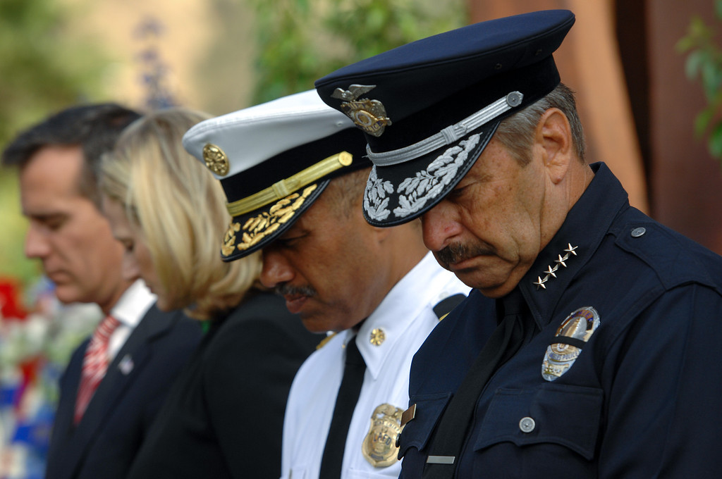 . From left, Mayor Eric Garcetti, his wife Amy Wakeland, LADF Chief Brian L. Cummings and LAPD Chief Charlie Beck bow their heads during the 9/11 Remembrance Ceremony at the World Trade Center Memorial at LAFD Frank Hotchkin Memorial Training Center, Thursday, September 11, 2013. (Photo by Michael Owen Baker/L.A. Daily News)