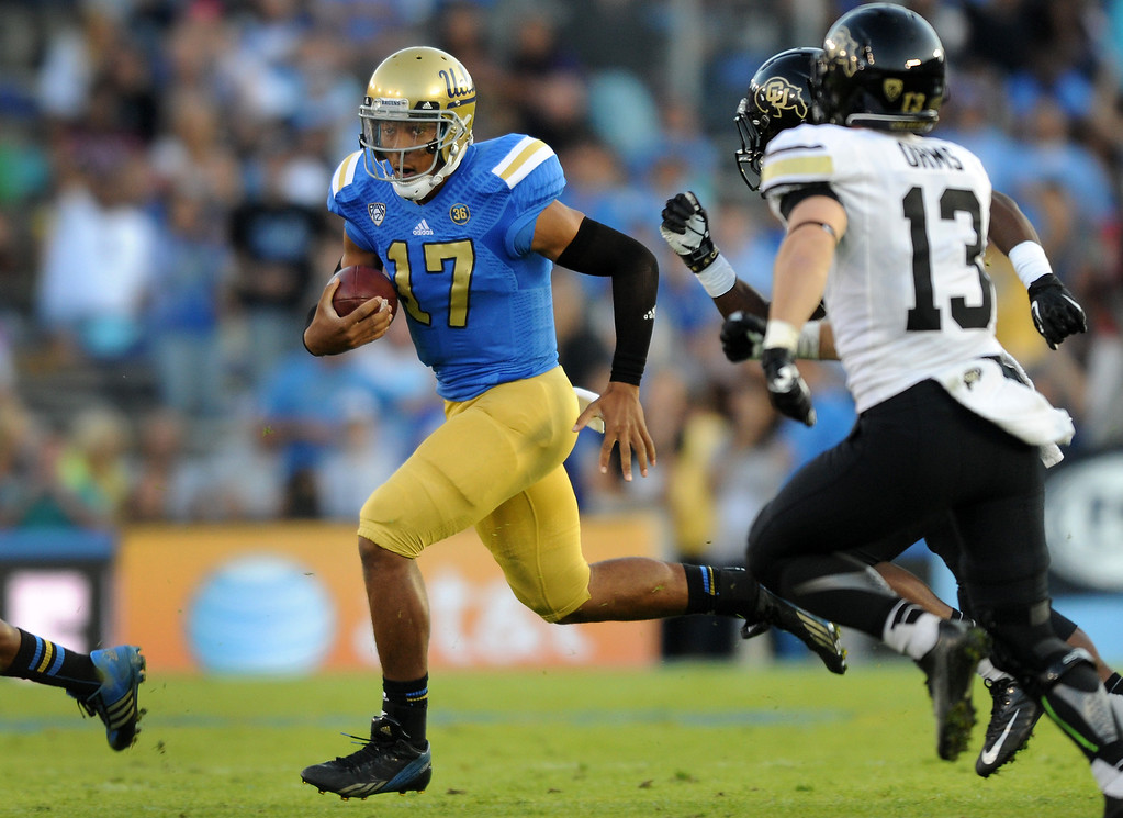 . UCLA QB Brett Hundley scrambles for yardage against Colorado in the second quarter, Saturday, November 2, 2013, at the Rose Bowl. (Photo by Michael Owen Baker/L.A. Daily News)