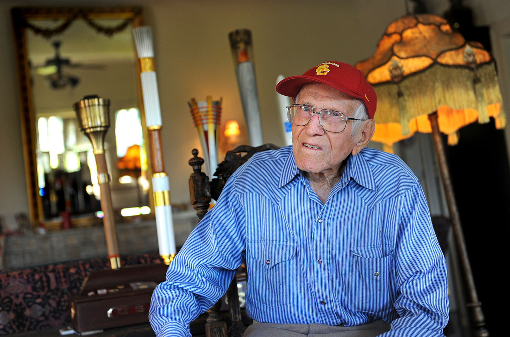 . Louis Zamperini, 94, at his Hollywood home. The flame still burns in him as he sits with the Olympic torches he has carried over the years. Photo by Brad Graverson 11-7-10