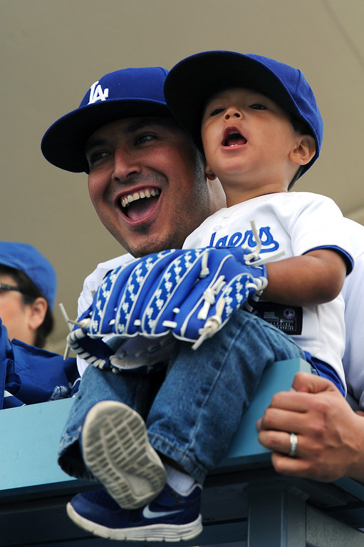 . John Rivera, of Moreno Valley, and his son Isaiah Rivera take in the view from the upper deck at the Dodgers home opener, Friday, April 4, 2014, at Dodger Stadium. (Photo by Michael Owen Baker/L.A. Daily News)