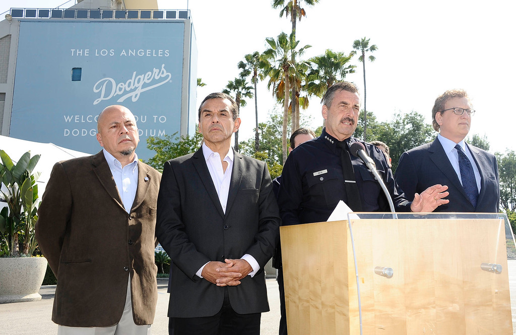 . (L-R) LA city councilman Ed Reyes,  LA mayor  Antonio Villaraigosa, LAPD Chief Charlie Beck and LA Dodgers senior vic president Howard Sunkin, talk during a press conference on the arrest of one of the two suspects of the brutal assault of a San Francisco Giants baseball fan on opening day at Dodger Stadium seven weeks ago at Dodger stadium. May 22,2011. photo by (Gene Blevins/L.A. Daily News)