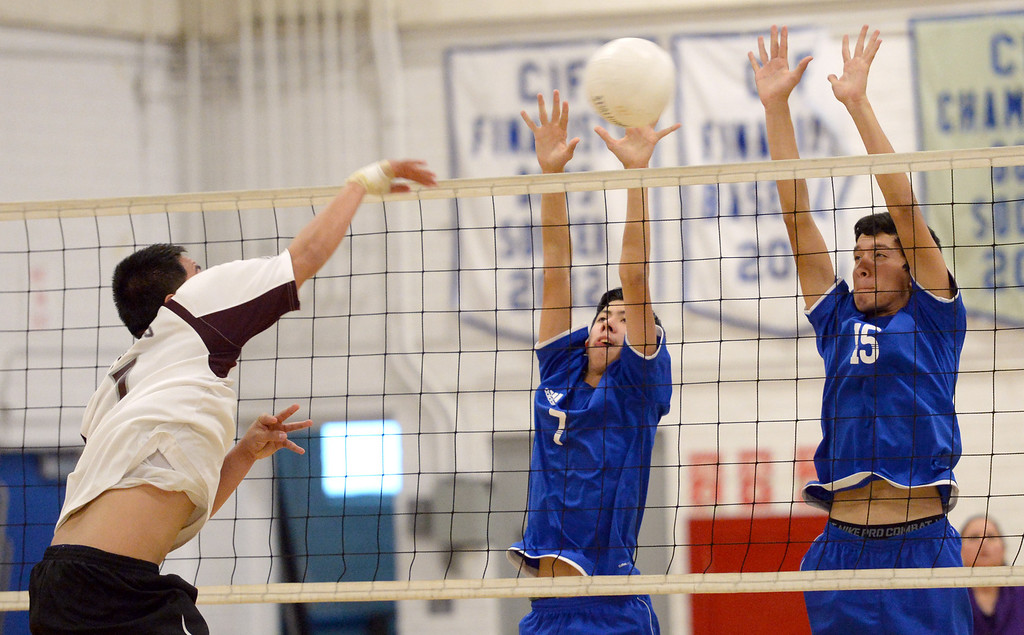 . El Rancho\'s Anthony Arauz-Diaz (#7) and Bryan Rojas (#15) block a shot from Bell Gardens\' Joseph Sagastume (#7) in their non-league game at El Rancho High School in Pico Rivera on Friday March 28, 2014. Bell Gardens defeated El Rancho 3-2 games. (Staff Photo by Keith Durflinger/Whittier Daily News)