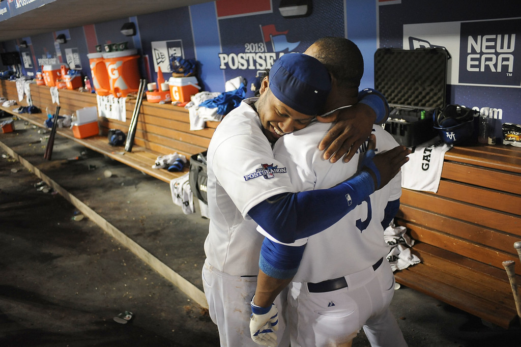 . Hanley Ramirez congratulates Juan Uribe after Uribe\'s 2-run game winning homerun in the 8th inning Monday, October 7, 2013 ( Photo by Andy Holzman/Los Angeles Daily News )