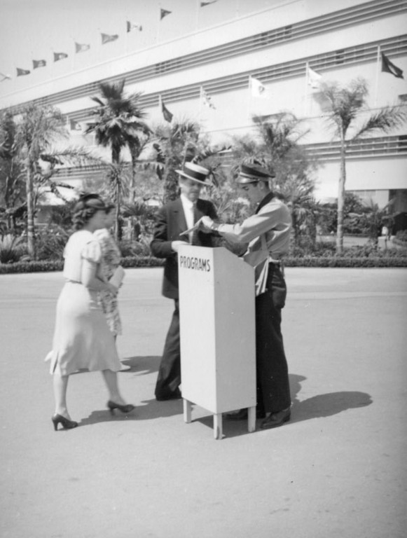 . Buying a program at Hollywood Park in 1938.   (Los Angeles Public Library)