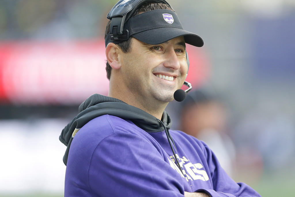 . Washington head coach Steve Sarkisian smiles on the sideline during an NCAA college football game against Oregon, Saturday, Oct. 12, 2013, in Seattle. (AP Photo/Ted S. Warren)