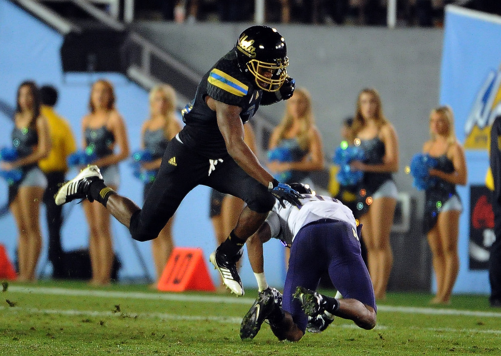 . UCLA Bruins\'s Paul Perkins (24) catches a pass for a first down against the Washington Huskies during the first half of their college football game in the Rose Bowl in Pasadena, Calif., on Friday, Nov. 15, 2013.  UCLA won 41-31. 