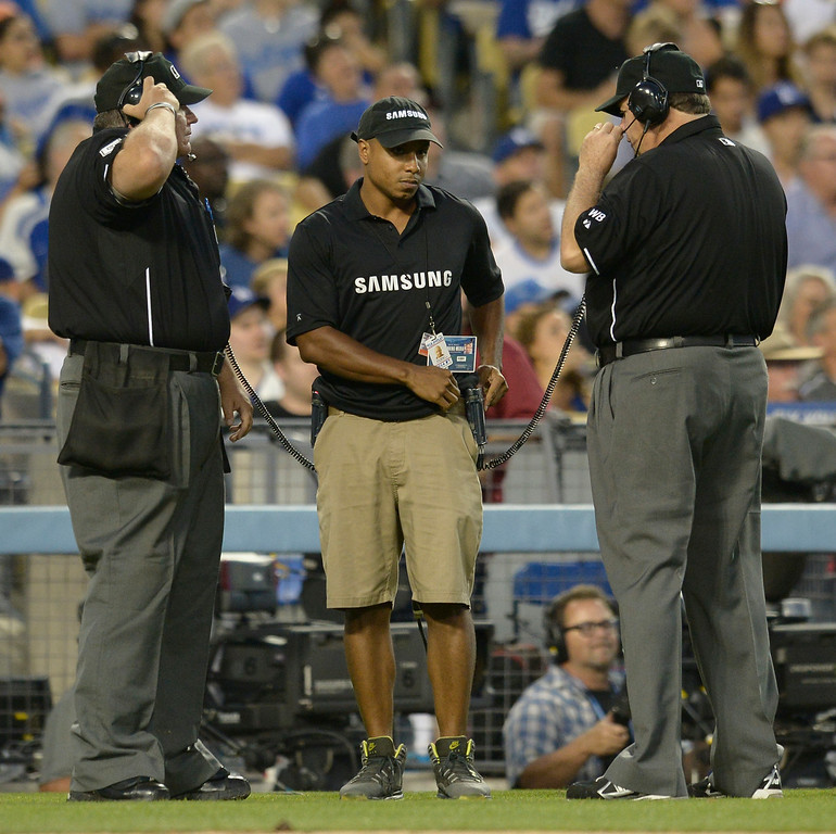 . Umpires review a play at 2nd base that found Dee Gordon out at 3rd base. The Dodgers played host to the Atlanta Braves in a game played at Dodger Stadium in Los Angeles, CA. 7/30/2014(Photo by John McCoy Daily News)