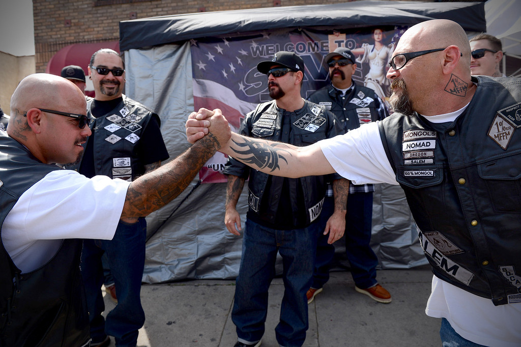. Mongols Clownie, of West Covina, and Magpie, of Salem, Oregon, greet each other as motorcycle club members rally Saturday, March 29, 2013 at The House Lounge in Maywood in support of the Mongols who are facing a federal trial seeking to take away their trademark patch. (Photo by Sarah Reingewirtz/Pasadena Star-News)