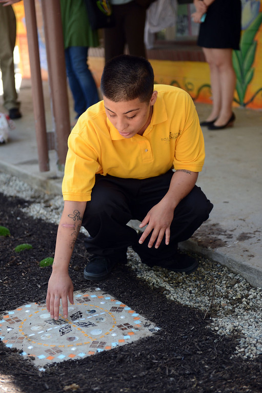 . Alma Reyna, 18-years-old, with the mosaic that she created in the Road to Success Academy at Probation Camp Scott in Santa Clarita Wednesday, May 22, 2013. (Hans Gutknecht/Los Angeles Daily News)