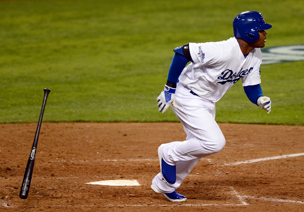 . The Dodger s\' Carl Crawford heads for first on a single in the 8th during game 3 against the St. Louis Cardinals in the NLCS at Dodger Stadium Monday, October 14, 2013. The Dodgers beat the Cardinals 3-0. (Photo by Sarah Reingewirtz/Los Angeles Daily News)
