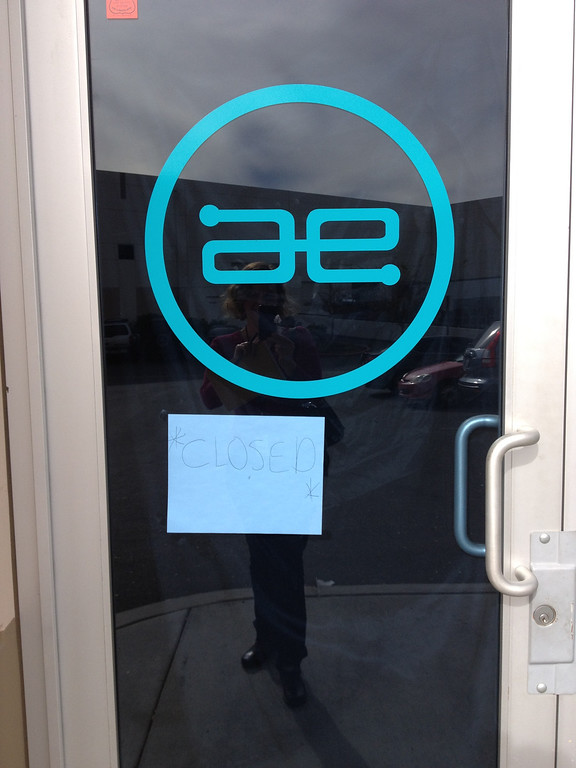 """. On Dec. 2, 2013, a \""""closed\"""" sign is hung in the door at Always Evolving, the Valencia business owned by Paul Walker and Roger Rodas, who died in a fiery Porsche crash on Nov. 30, 2013. (Photo by Brenda Gazzar/Los Angeles Daily News)"""