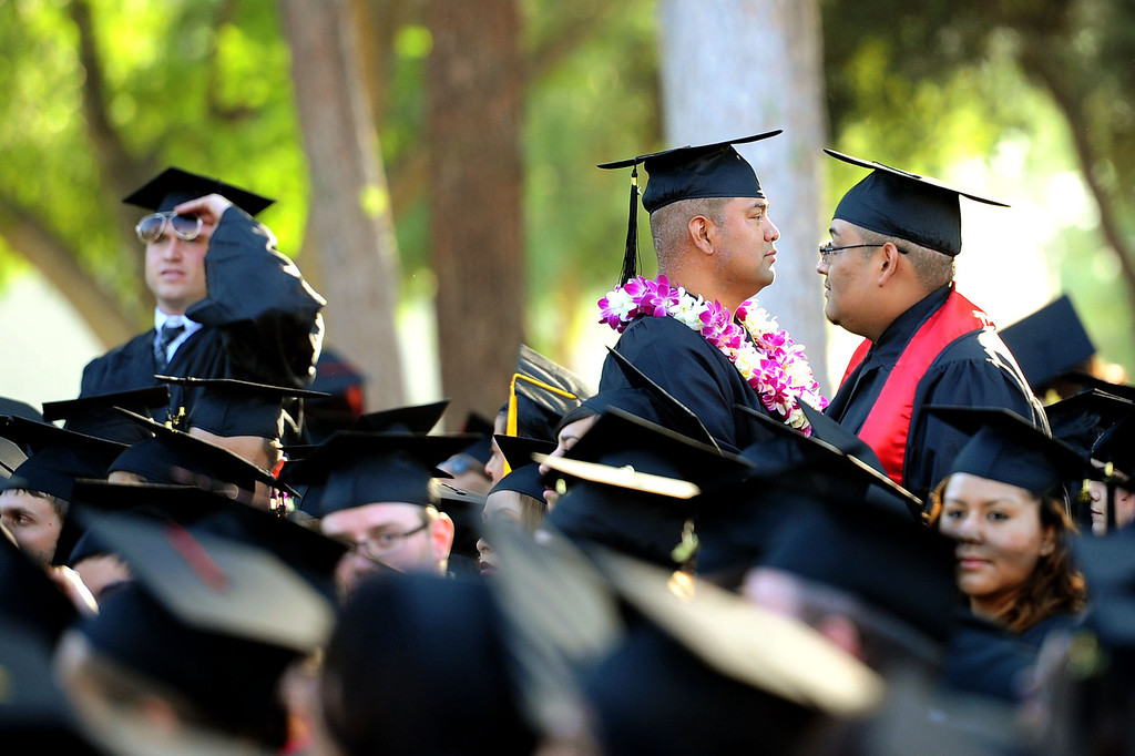 . Students participate in the 2014 Commencement Ceremony at Pierce College June 10, 2014.(Andy Holzman/Los Angeles Daily News)