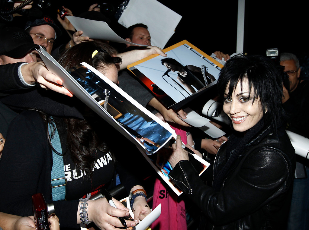 ". Musician Joan Jett signs autographs for fans at the premiere of ""The Runaways\"" in Los Angeles on Thursday, March 11, 2010. (AP Photo/Matt Sayles)"