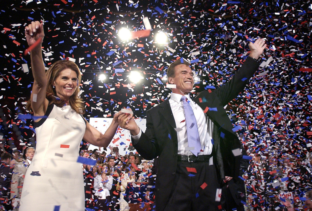 . Republican Arnold Schwarzenegger is joined by wife Maria Shriver as he celebrates his victory in the California gubernatorial recall election in Los Angeles, Tuesday, Oct. 7, 2003. (AP Photo/Stephan Savoia)