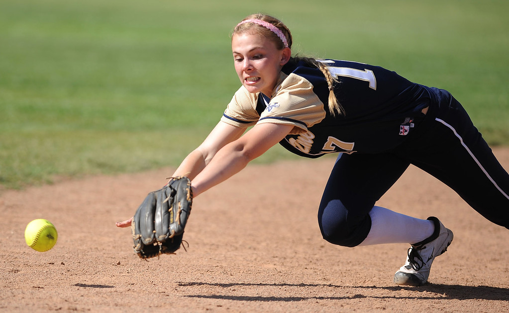 . Notre Dame shortstop Emily Waters makes a diving attempt on an Alemany groundball during their Mission League softball showdown in Encino, CA April 8, 2014.  Alemany won the game, 5-4.(Andy Holzman/Los Angeles Daily News)