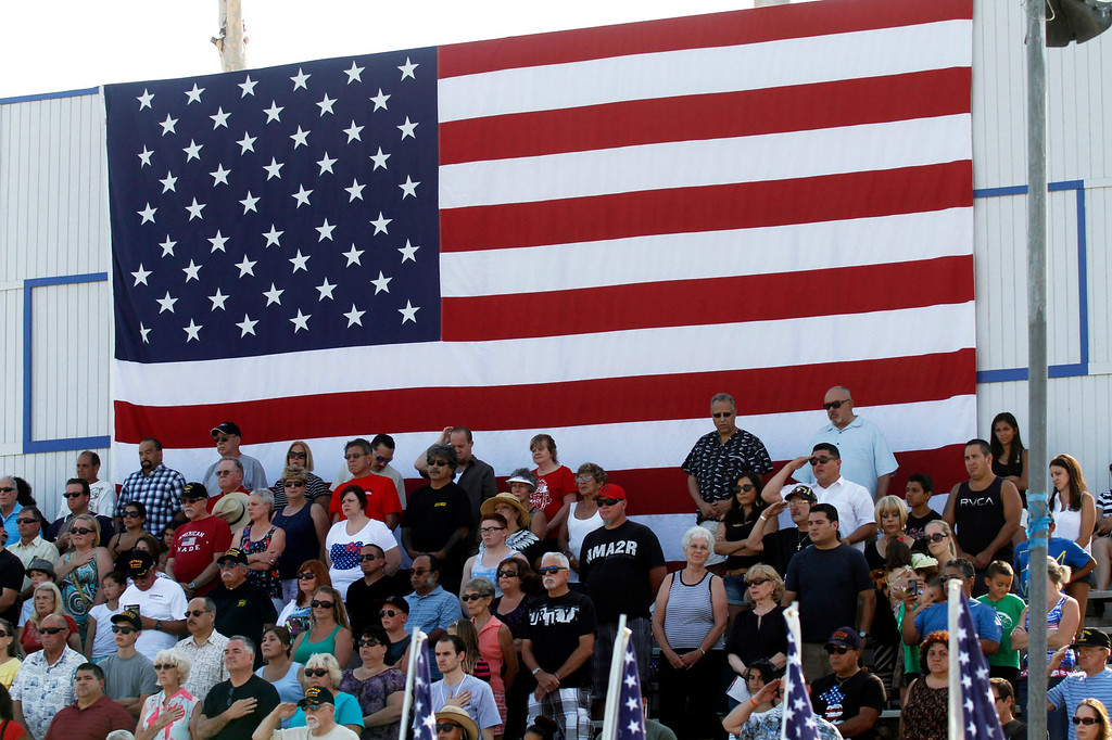 """. Guests stand and salute during the \""""Last Bugle Call,\"""" during the Vietnam Veterans Memorial \""""The Wall That Heals\"""" Closing Ceremony event, at La Habra High School, in La Habra, Sunday, July 14, 2013. (SGVN/Correspondent Photo by James Carbone)"""