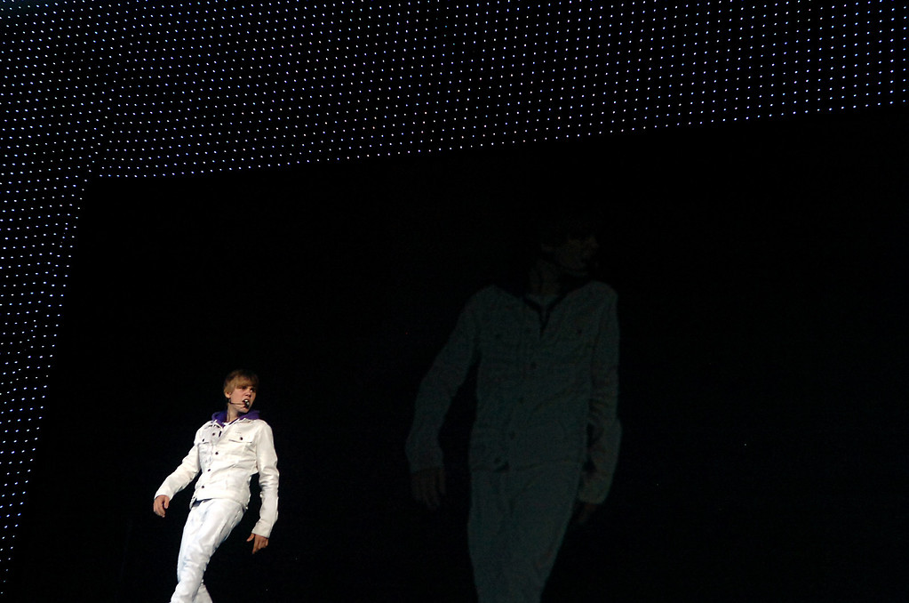 ". Justin Bieber performs Sunday, October 24, 2010, during his ""My World\"" tour at Citizen\'s Business Bank Arena in Ontario.