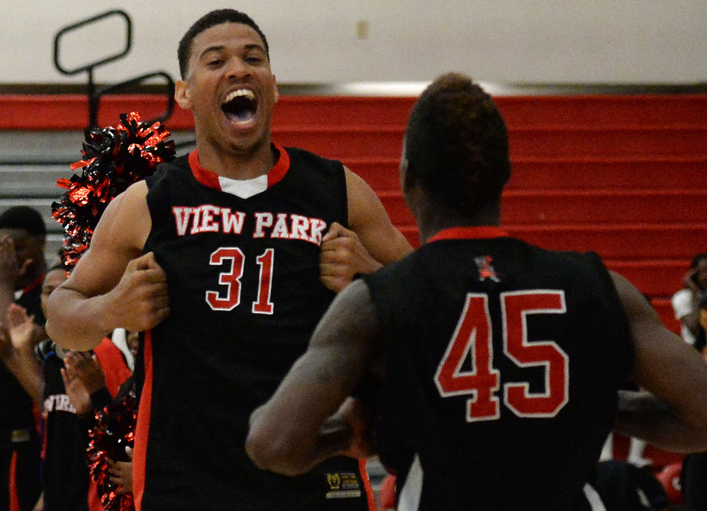 . View Park\'s Jason Carter (C) (31) reacts with teammate Luis Medearis prior to a CIF Southern California Regional Division basketball game against Renaissance Academy at Colony High School in Ontario, Calif., on Saturday, March 22, 2014.  (Keith Birmingham Pasadena Star-News)