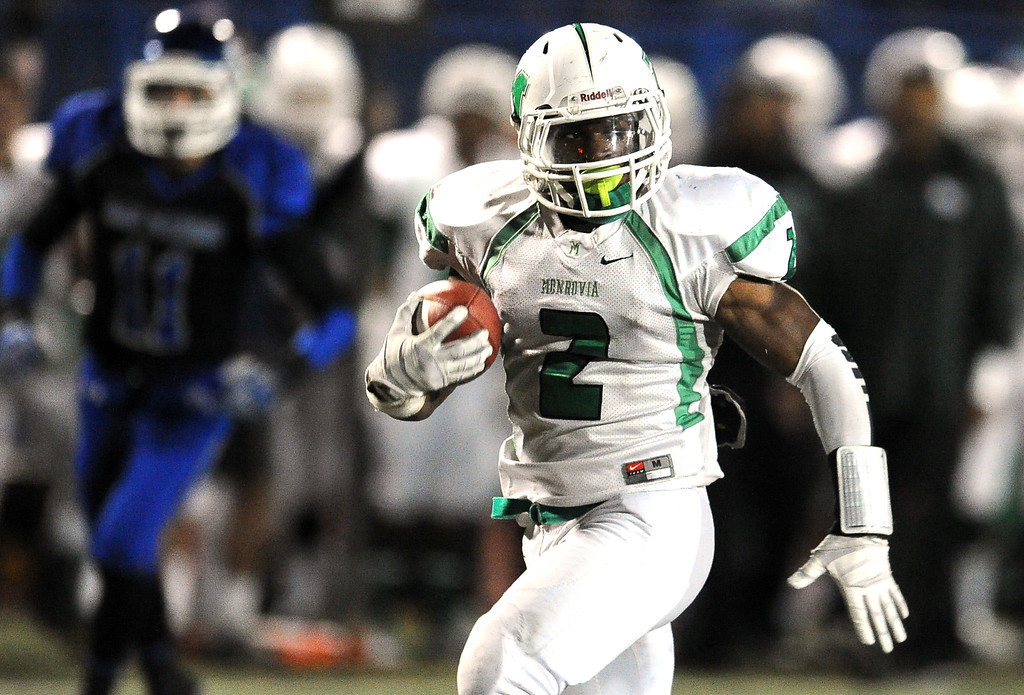 . Monrovia\'s Kurt Scoby catches a pass for a touchdown against San Marino in the first half of a prep football game at Monrovia High School in Monrovia, Calif., on Friday, Nov. 8, 2013.    (Keith Birmingham Pasadena Star-News)