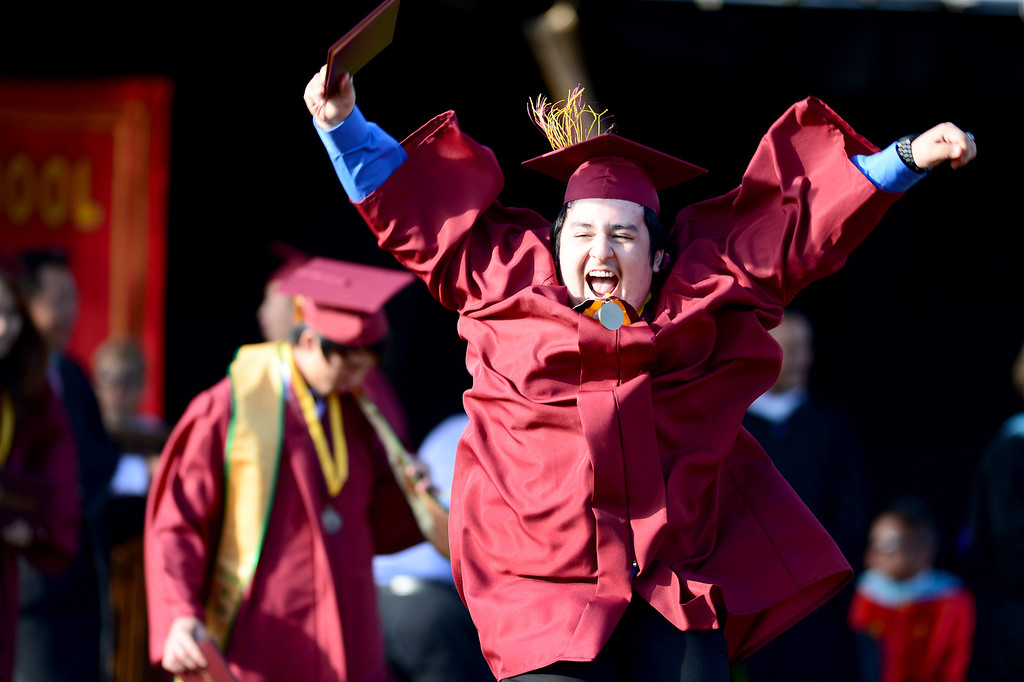 . Abraham Cervantes, 17, celebrates after receiving his diploma during Wilson High School\'s forty-seventh commencement ceremony Tuesday evening, May 20, 2014 at the Hacienda Heights school. (Photo by Sarah Reingewirtz/Pasadena Star-News)