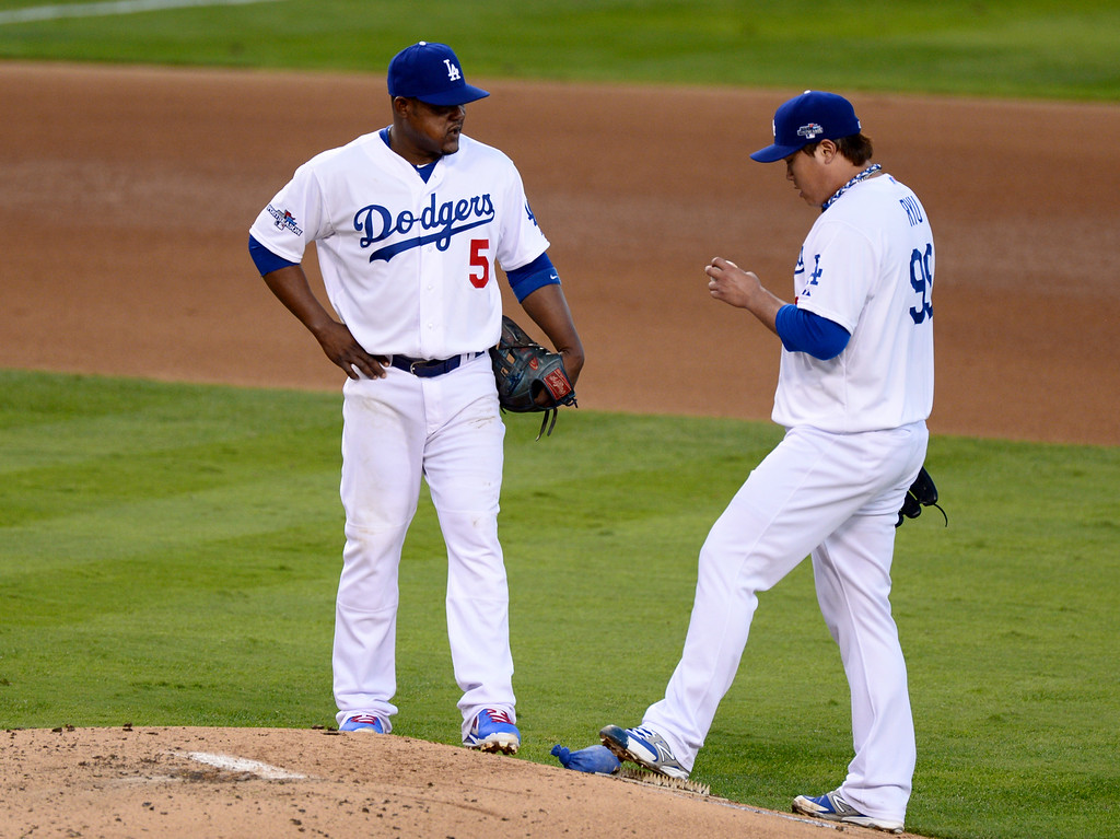 . Dodger pitcher Hyun-Jin Ryu talks with Juan Uribe during game 3 of the NLCS at Dodger Stadium Monday, October 14, 2013. The Dodgers beat the Cardinals 3-0. (Photo by Sarah Reingewirtz/Los Angeles Daily News)