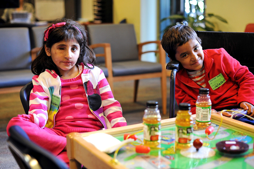 ". ""Shabibi\"" and \""Abdul wait to see doctors at the Shriners Hospital for Children in Los Angeles, CA December 13, 2013.  The Afghan children were injured by bomb and grenade blasts and have been brought to the U.S. by the Los Angeles-based organization Children of War Foundation and will be receive treatment at the hospital.(Andy Holzman/Los Angeles Daily News)"
