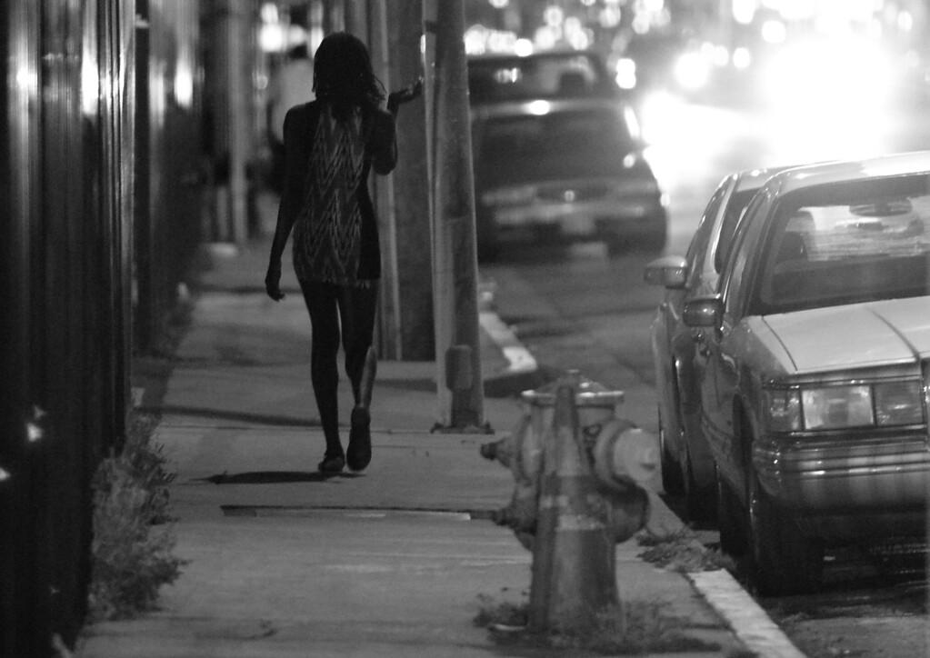 . A woman walks down Sepulveda Blvd. near Rayen Street. North Hills, CA. 4/30/2014(Photo by John McCoy / Los Angeles Daily News)