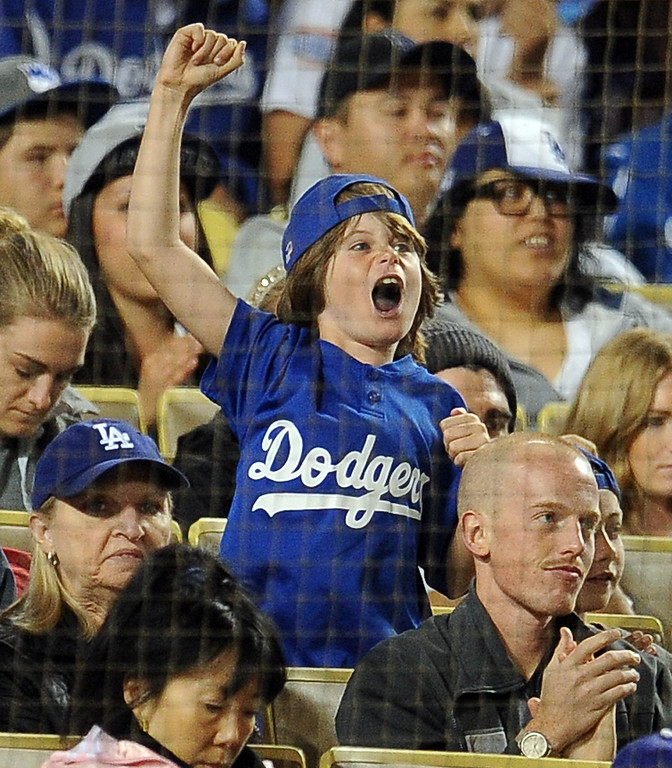 . A Los Angeles Dodgers fan tries to cheer on his team in the sixth inning of their baseball game against the San Diego Padres on Wednesday, April 17, 2013 in Los Angeles.   (Keith Birmingham/Pasadena Star-News)
