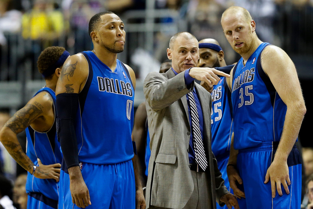 . Dallas Mavericks head coach Rick Carlisle, center, talks to Dallas players Shawn Marion, left, and Chris Kaman, right, during an exhibition basketball game against Alba Berlin in Berlin, Saturday, Oct. 6, 2012. (AP Photo/Markus Schreiber)