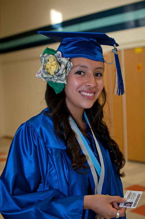 . Graduate Karen Carrillo wears a flower of money given to her as a gift.  The Reseda High School graduation class held their commencement in the school football field on Friday,  June 07, 2013 in Reseda, CA.   Photo by Carlos Carpio