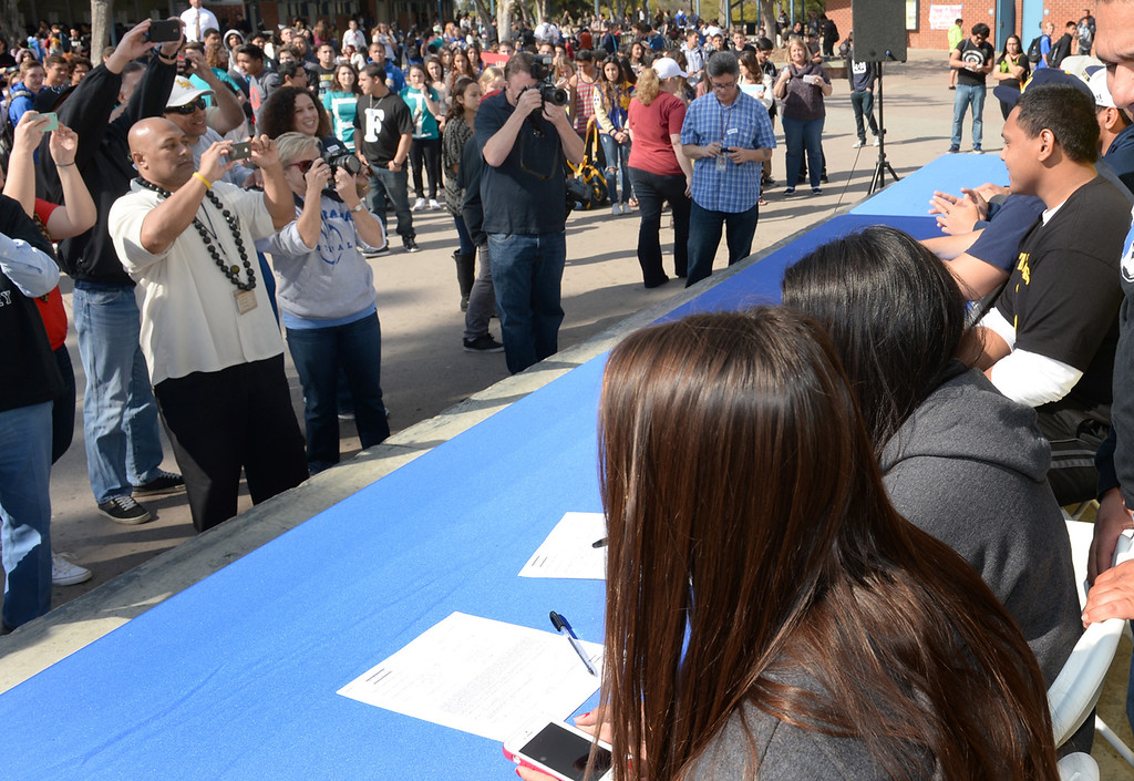 . Football and girls soccer players appear during National Signing Day at La Mirada High School on Wednesday February 5, 2014. (Staff Photo by Keith Durflinger/Whittier Daily News)