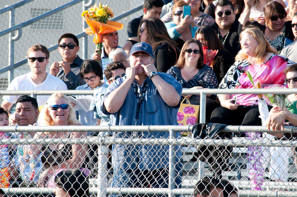 . Proud father whistles during the graduation ceremony of Reseda High School.The Reseda High School graduation class held their commencement in the school football field on Friday,  June 07, 2013 in Reseda, CA.   Photo by Carlos Carpio