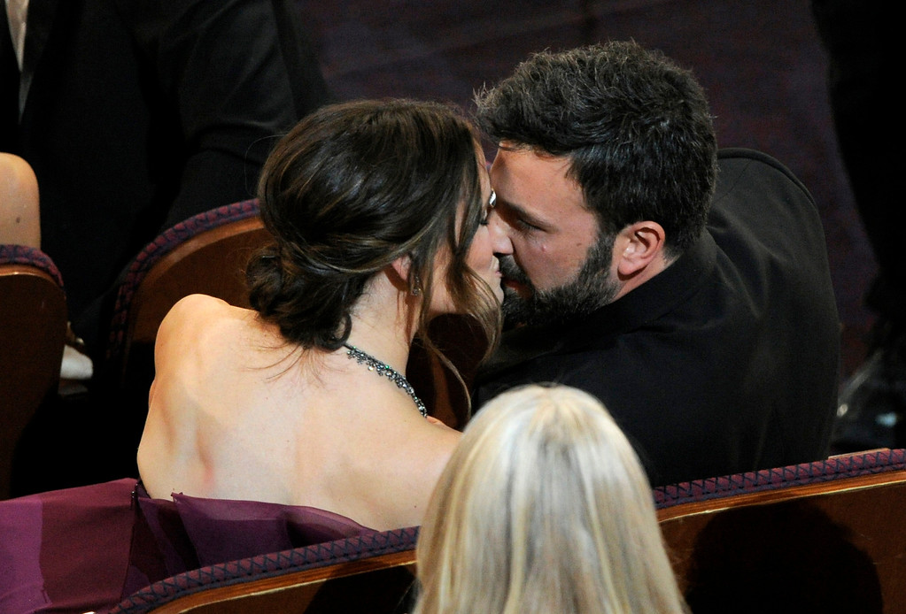 """. Jennifer Garner, left, kisses director Ben Affleck after \""""Argo\"""" is announced the winner for the award for best picture during the Oscars at the Dolby Theatre on Sunday Feb. 24, 2013, in Los Angeles.  (Photo by Chris Pizzello/Invision/AP)"""