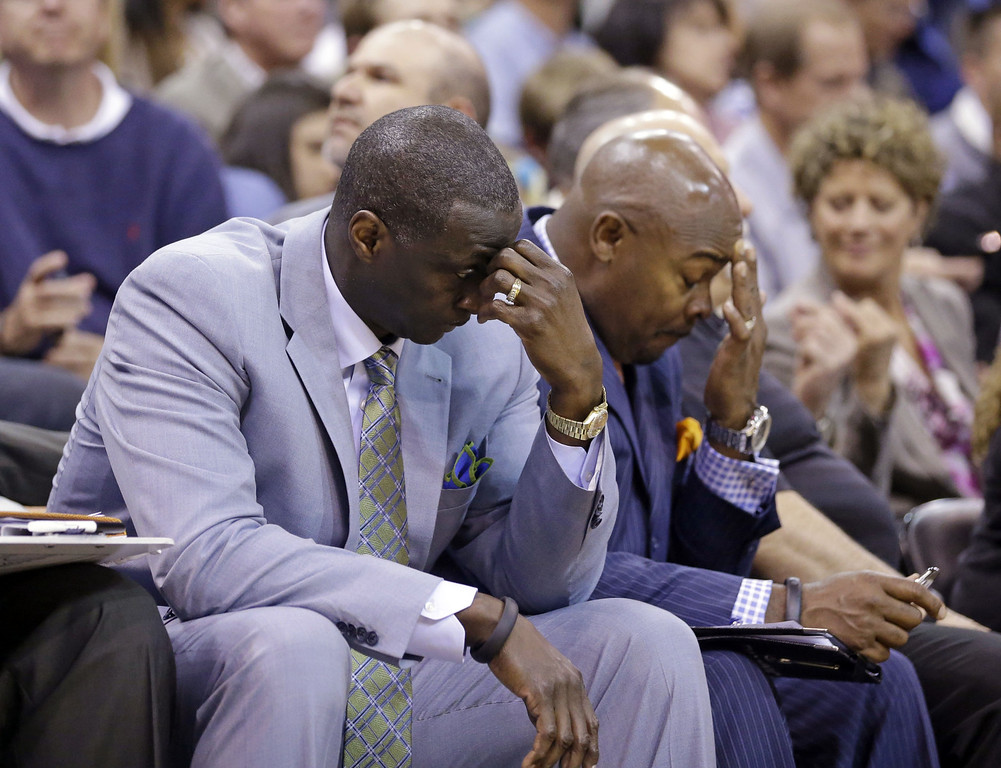 . Utah Jazz\'s head coach Tyrone Corbin, left, lowers his head late in the fourth quarter during an NBA basketball game against the Los Angeles Lakers Monday, April 14, 2014, in Salt Lake City, Utah. The Lakers won 119-104. (AP Photo/Rick Bowmer)