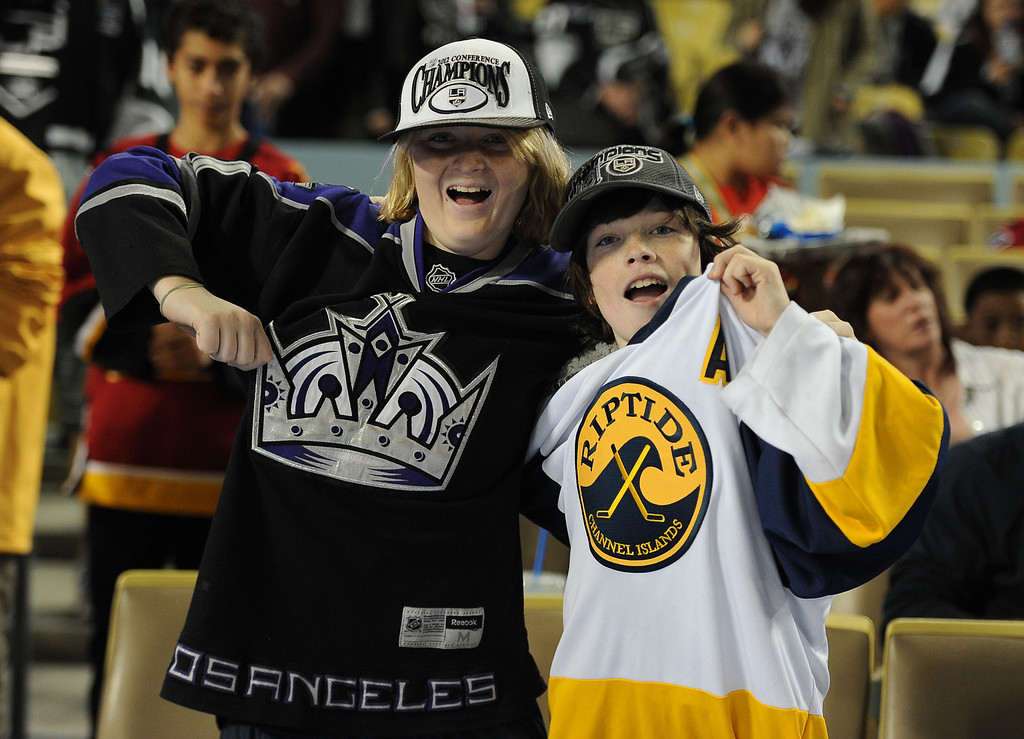 . Los Angeles Kings fans pose for photographs prior to the start of the inaugural NHL Stadium Series game against the Anaheim Ducks at Dodger Stadium in Los Angeles on Saturday, Jan. 25, 2014. (Keith Birmingham Pasadena Star-News)