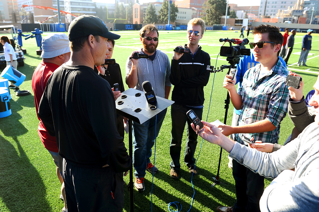 . UCLA head coach Jim Mora fields questions from the media following the final day of spring practice Thursday, April 24, 2014.(Andy Holzman/Los Angeles Daily News)